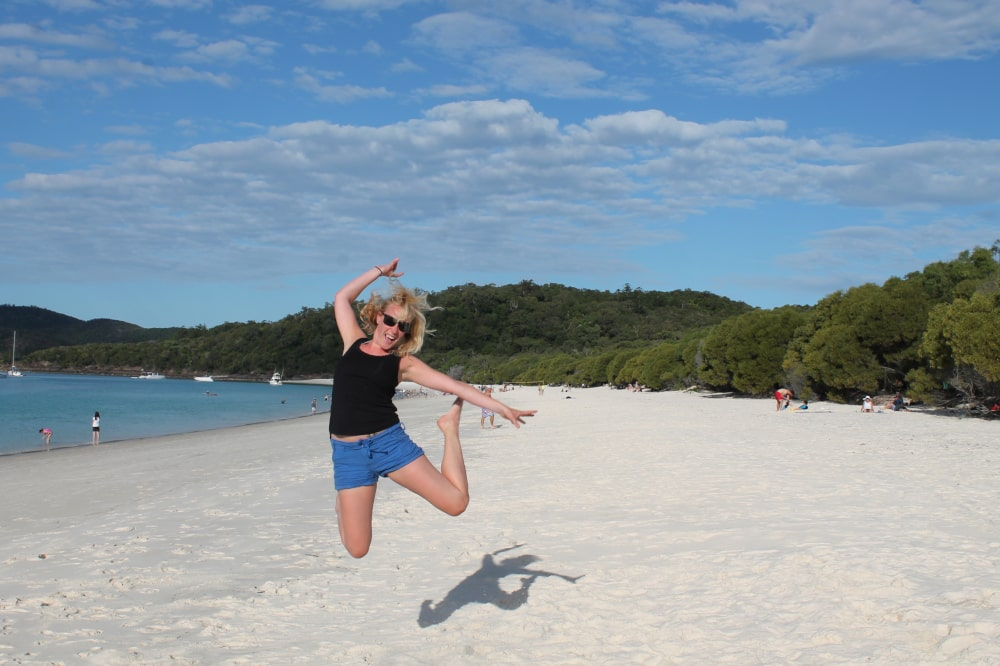 Jumping for joy on the most beautiful beach in Australia